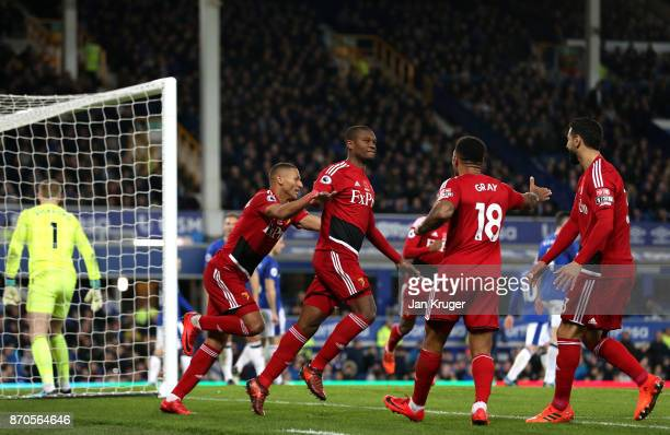 Christian Kabasele of Watford celebrates scoring his sides second goal with his Watford team mates during the Premier League match between Everton...