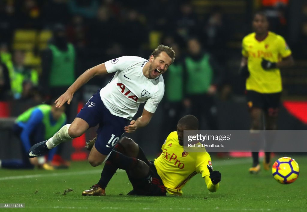 Christian Kabasele of Watford fouls Harry Kane of Tottenham Hotspur during the Premier League match between Watford and Tottenham Hotspur at Vicarage Road on December 2, 2017 in Watford, England.