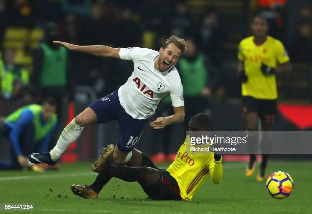 Christian Kabasele of Watford fouls Harry Kane of Tottenham Hotspur during the Premier League match between Watford and Tottenham Hotspur at Vicarage...
