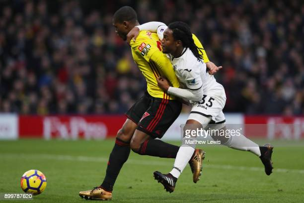 Christian Kabasele of Watford is challenged by Renato Sanches of Swansea City during the Premier League match between Watford and Swansea City at...