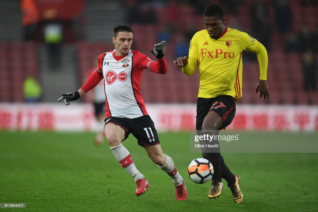 Christian Kabasele of Watford is challenged Dusan Tadic of Southampton during The Emirates FA Cup Fourth Round match between Southampton and Watford at St Mary's Stadium on January 27, 2018 in Southampton, England.