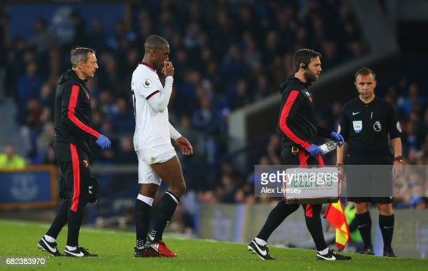Christian Kabasele of Watford is forced off due to injury during the Premier League match between Everton and Watford at Goodison Park on May 12 2017...