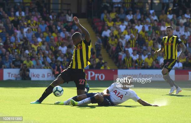 Christian Kabasele of Watford is tackled by Lucas Moura of Tottenham Hotspur during the Premier League match between Watford FC and Tottenham Hotspur...