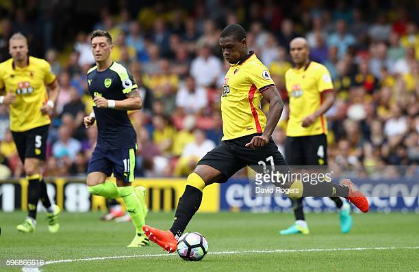 Christian Kabasele of Watford passes the ball during the Premier League match between Watford and Arsenal at Vicarage Road on August 27 2016 in...