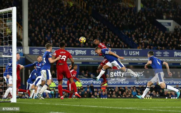 Christian Kabasele of Watford scores his sides second goal during the Premier League match between Everton and Watford at Goodison Park on November 5...