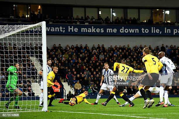Christian Kabasele of Watford scores his team's first goal during the Premier League match between West Bromwich Albion and Watford at The Hawthorns...