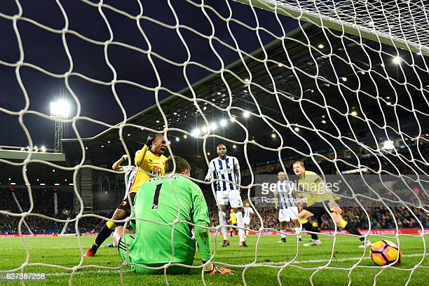 Christian Kabasele of Watford scores his team's first goal past Ben Foster of West Bromwich Albion during the Premier League match between West...