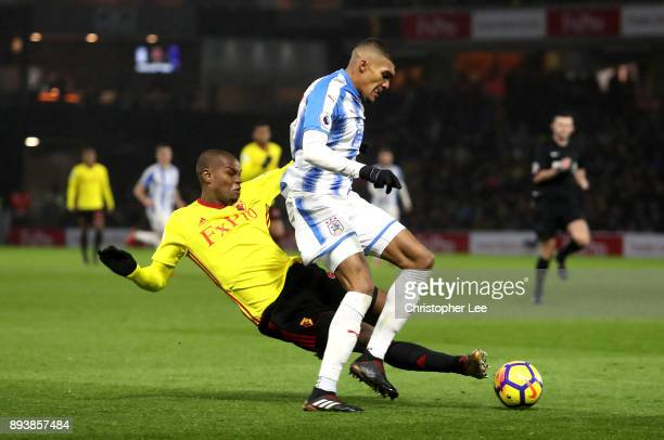 Christian Kabasele of Watford tackles Collin Quaner of Huddersfield Town during the Premier League match between Watford and Huddersfield Town at...