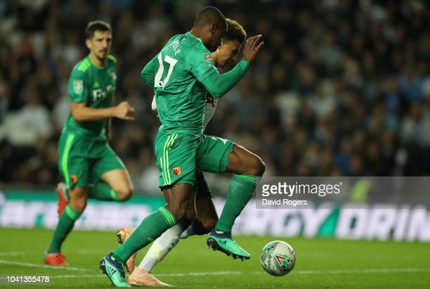 Christian Kabasele of Watford tackles Dele Alli to concede a penalty during the Carabao Cup Third Round match between Tottenham Hotspur and Watford...