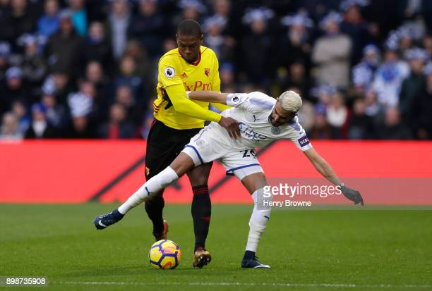 Christian Kabasele of Watford tackles Riyad Mahrez of Leicester City during the Premier League match between Watford and Leicester City at Vicarage...