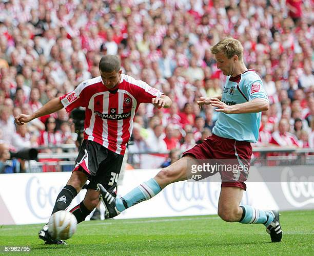Christian Kallvenes of Burnley and KyleWalker of Sheffield United vie for the ball during the Championship PlayOff Final between Burnley FC and...