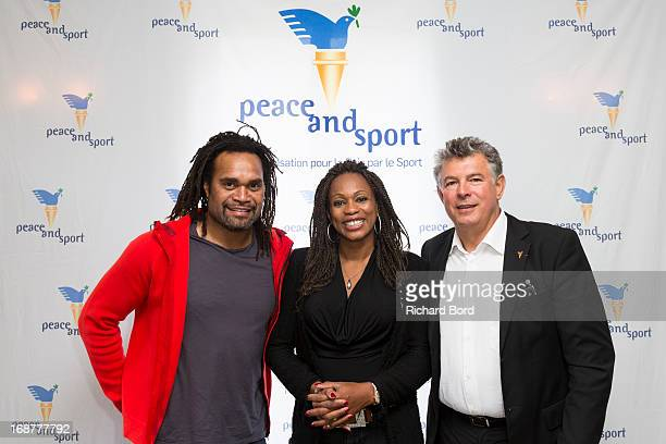 Christian Karembeu Laura Flessel and 'Peace and Sport' president Joel Bouzou pose during the 'Peace and Sport' France launch at Pavillon Ledoyen on...
