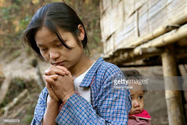 Christian Karen woman living in a displaced people community in the Northern Karen State jungle is praying For years the Burmese army has been...