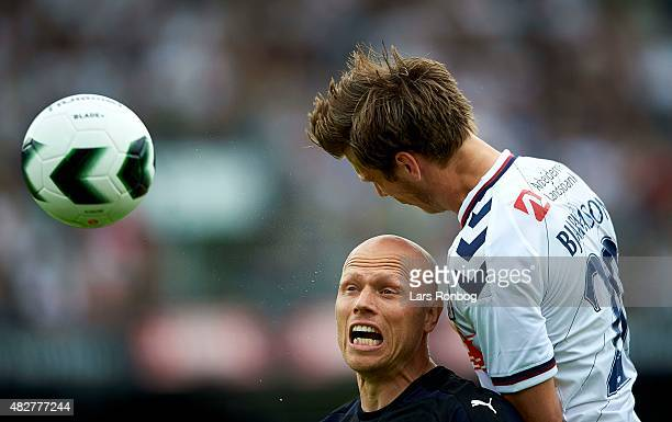 Christian Keller of Randers FC and Elmar Bjarnason of AGF Aarhus compete for the ball during the Danish Alka Superliga match between AGF Aarhus and...