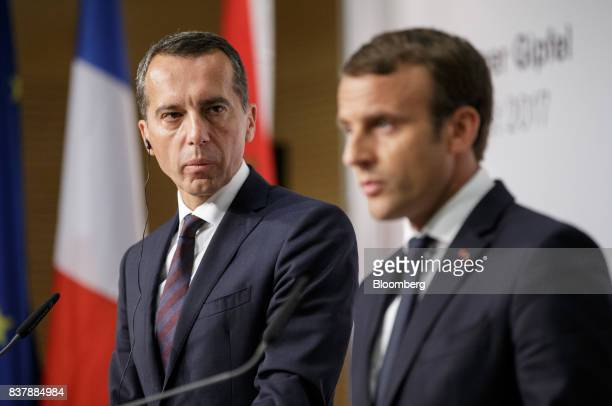 Christian Kern Austria's chancellor left looks on as Emmanuel Macron France's president speaks during a news conference in Salzburg Austria on...