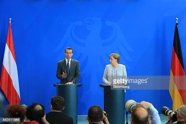 Christian Kern Austria's chancellor left speaks as Angela Merkel Germany's chancellor looks on during a news conference at the Chancellory in Berlin...