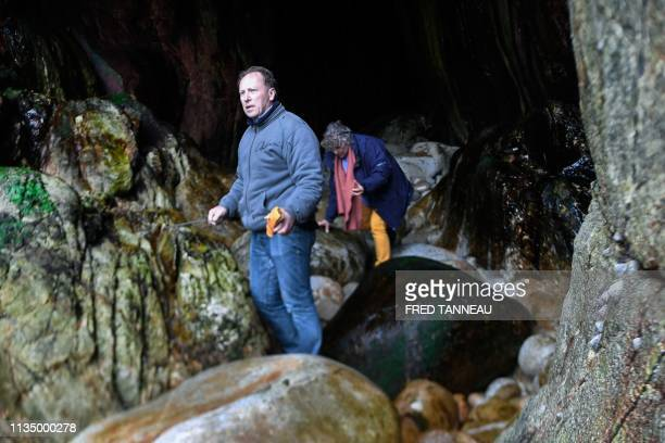 Christian KervelleLety a voluntary of the French association Ar Viltansou searches at the entry of a partially submerged cave only accessible at low...