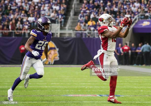 Christian Kirk of the Arizona Cardinals catches the ball in the first quarter of the game against Trae Waynes of the Minnesota Vikings at US Bank...