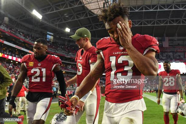 Christian Kirk of the Arizona Cardinals reacts while walking off the field in front of Josh Rosen and Patrick Peterson after the loss against the...