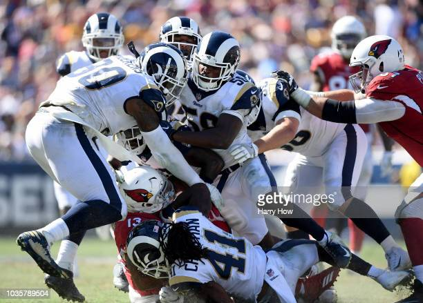 Christian Kirk of the Arizona Cardinals tackled by Sean Mannion, Michael Brockers, and Cory Littleton of the Los Angeles Rams during the fourth...