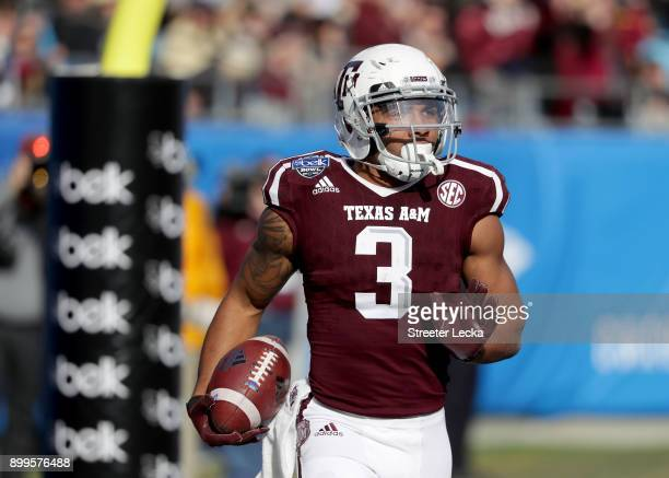 Christian Kirk of the Texas AM Aggies catches a touchdown against the Wake Forest Demon Deacons during the Belk Bowl at Bank of America Stadium on...