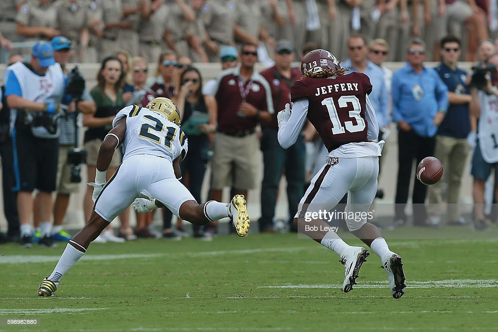 Christian Kirk #3 of the Texas A&M Aggies has the ball knockled loose by Tahaan Goodman #21 of the UCLA Bruins after a reception for a fumble in the first quarter at Kyle Field on September 3, 2016 in College Station, Texas. UCLA recovered the ball.