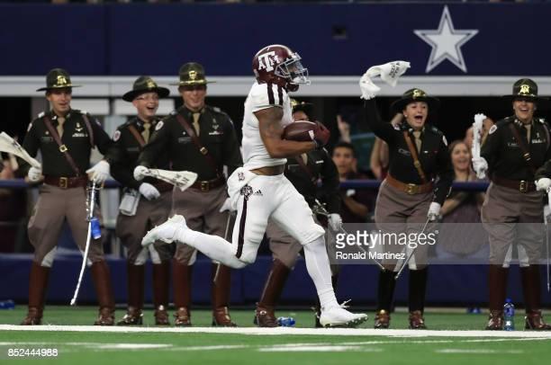 Christian Kirk of the Texas AM Aggies runs for a 100 yard kickoff return for a touchdown in the fourth quarter against the Arkansas Razorbacks at ATT...