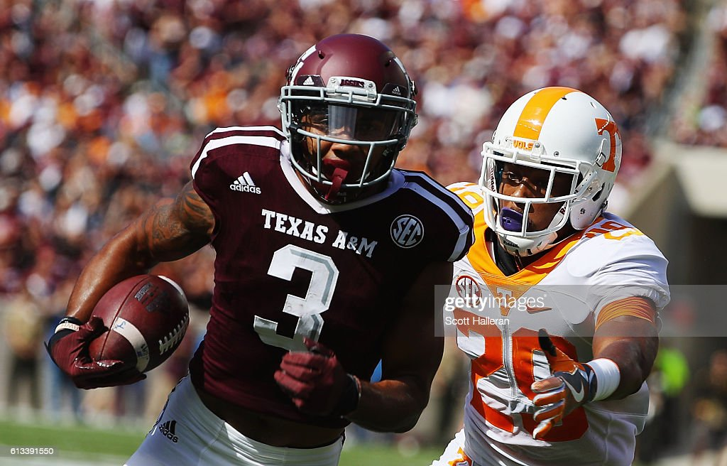 Christian Kirk #3 of the Texas A&M Aggies runs for a 13 yard touchdown past Evan Berry #29 of the Tennessee Volunteers in the first half of their game at Kyle Field on October 8, 2016 in College Station, Texas.