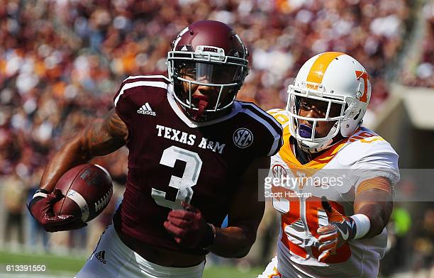 Christian Kirk of the Texas A&M Aggies runs for a 13 yard touchdown past Evan Berry of the Tennessee Volunteers in the first half of their game at...