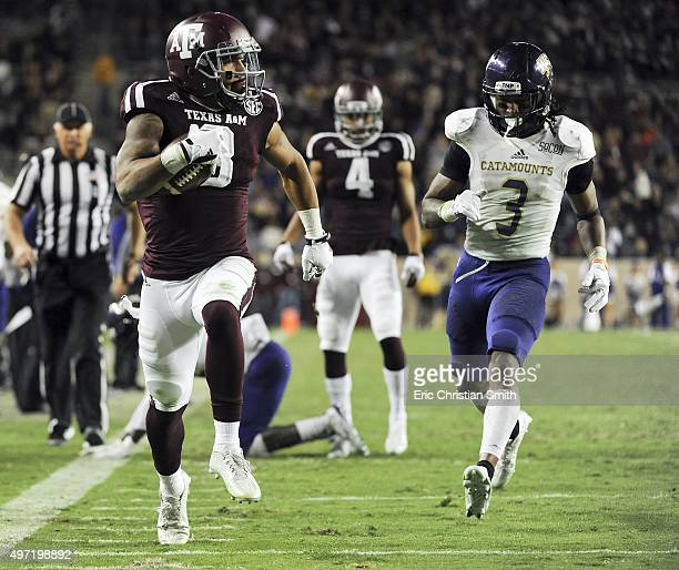 Christian Kirk of the Texas AM Aggies runs past Fred Payne of the Western Carolina Catamounts for a 22yard touchdown reception in the fourth quarter...
