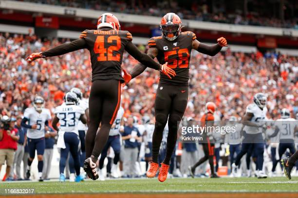 Christian Kirksey of the Cleveland Browns and Morgan Burnett celebrate after making a defensive stop during the third quarter of the game against the...