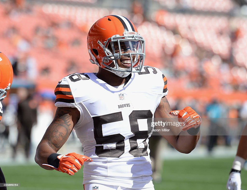 Christian Kirksey #58 of the Cleveland Browns laughs while warming up prior to the game against the Baltimore Ravens at FirstEnergy Stadium on September 21, 2014 in Cleveland, Ohio.