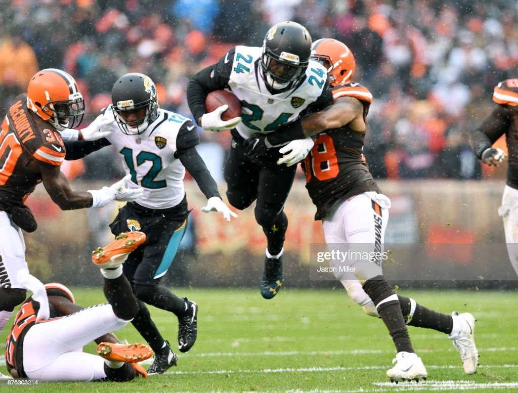 Christian Kirksey #58 of the Cleveland Browns tackles T.J. Yeldon #24 of the Jacksonville Jaguars in the first half at FirstEnergy Stadium on November 19, 2017 in Cleveland, Ohio.