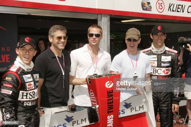 Christian Klein , George Clooney, Brad Pitt, Matt Damon and Mark Webber pose during a guided tour of the Jaguar garage as the official guests of...