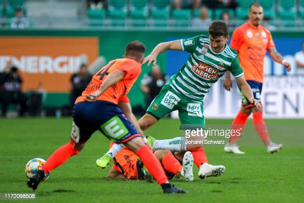 Christian Klem Juergen Heil of Hartberg and Stephan Auer of Rapid during tipico Bundesliga match between SK Rapid Wien and TSV Prolactal Hartberg at...