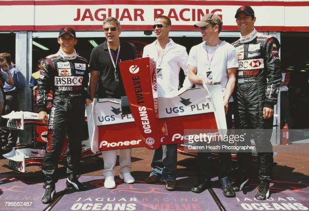 Christian Klien, actors George Clooney, Brad Pitt, Matt Damon and driver Mark Webber pose outside the Jaguar garage for a photo-call as the official...