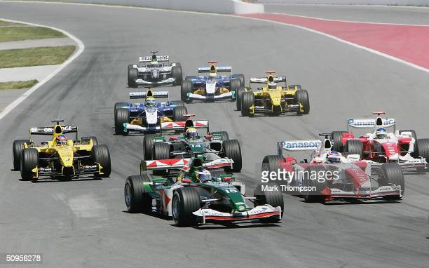 Christian Klien of Austria and Jaguar and Mark Webber of Australia and Jaguar in amongst the pack as they head in to the first corner during the...