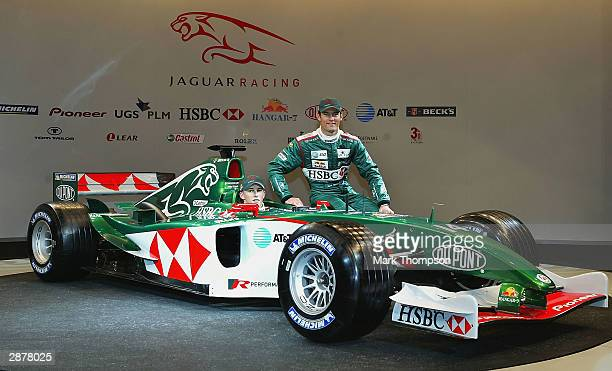 Christian Klien of Austria and Jaguar and team mate Mark Webber of Australia and Jaguar pose with the new Jaguar R5 during the Jaguar R5 Formula One...