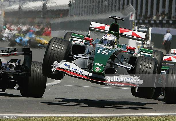 Christian Klien of Austria and Jaguar in the air after his car made contact with David Coulthard of Great Britain and McLaren Mercedes into the...