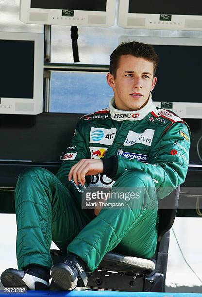 Christian Klien of Austria and Jaguar relaxes on the pit wall during preseason Formula One Testing at the Circuito de Jerez on February 12 2004 in...