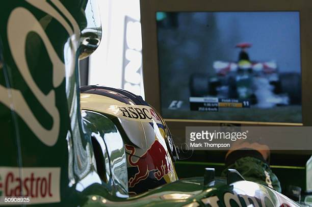 Christian Klien of Austria and Jaguar watches Mark Webber of Australia and Jaguar from his cockpit during the qualifying session for the European F1...