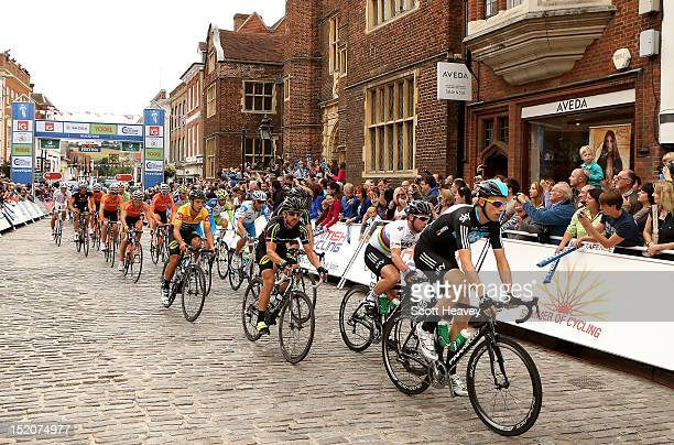 Christian Knees of Germany and Mark Cavendish of Great Britain pass through Guildford High Street during the 1st passage of the final stage of the...