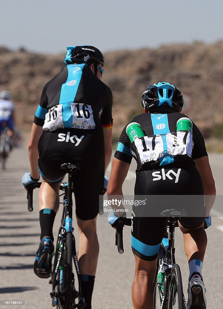 Christian Knees of Germany and Richie Porte of Australia carry water bottles to their team during stage six of the 2013 Tour of Oman from Hawit Nagam Park to the Matrah Corniche on February 16, 2013 in Matrah, Oman.