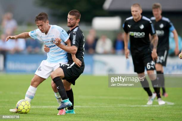 Christian Kohler of FC Helsingor and Perry Kitchen of Randers FC compete for the ball during the Danish Alka Superliga match between FC Helsingor and...