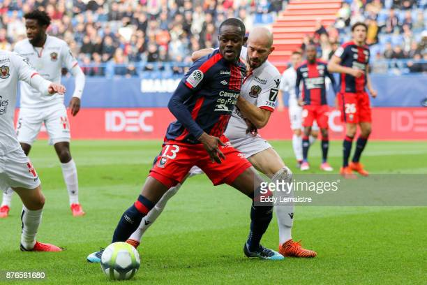 Christian Kouakou of Caen and Christophe Jallet of Nice during the Ligue 1 match between SM Caen and OGC Nice at Stade Michel D'Ornano on November 19...