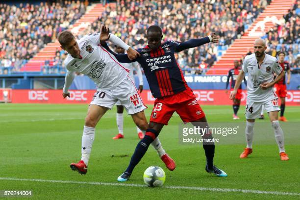 Christian Kouakou of Caen and Maxime Le Marchand of Nice during the Ligue 1 match between SM Caen and OGC Nice at Stade Michel D'Ornano on November...