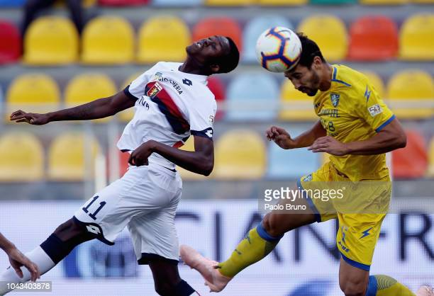 Christian Kouame of Genoa CFC competes for the ball with Edoardo Goldaniga of Frosinone Calcio during the Serie A match between Frosinone Calcio and...