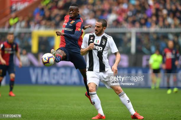 Christian Kouame of Genoa CFC is challenged by Leonardo Bonucci of Juventus during the Serie A match between Genoa CFC and Juventus at Stadio Luigi...