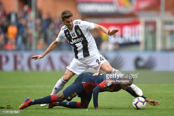Christian Kouame of Genoa CFC is tackled by Daniele Rugani of Juventus during the Serie A match between Genoa CFC and Juventus at Stadio Luigi...
