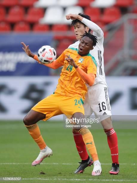 Christian Kouame of Ivory Coast, Takehiro Tomiyasu of Japan during the International Friendly match between Japan v Ivory Coast at the Stadium...